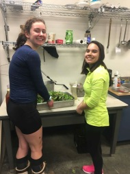 Eva and Keiko cooking for the pasta dinner