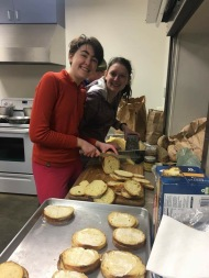 Lily and Hannah making food for the pasta dinner