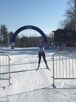 Portia crossing the finish line